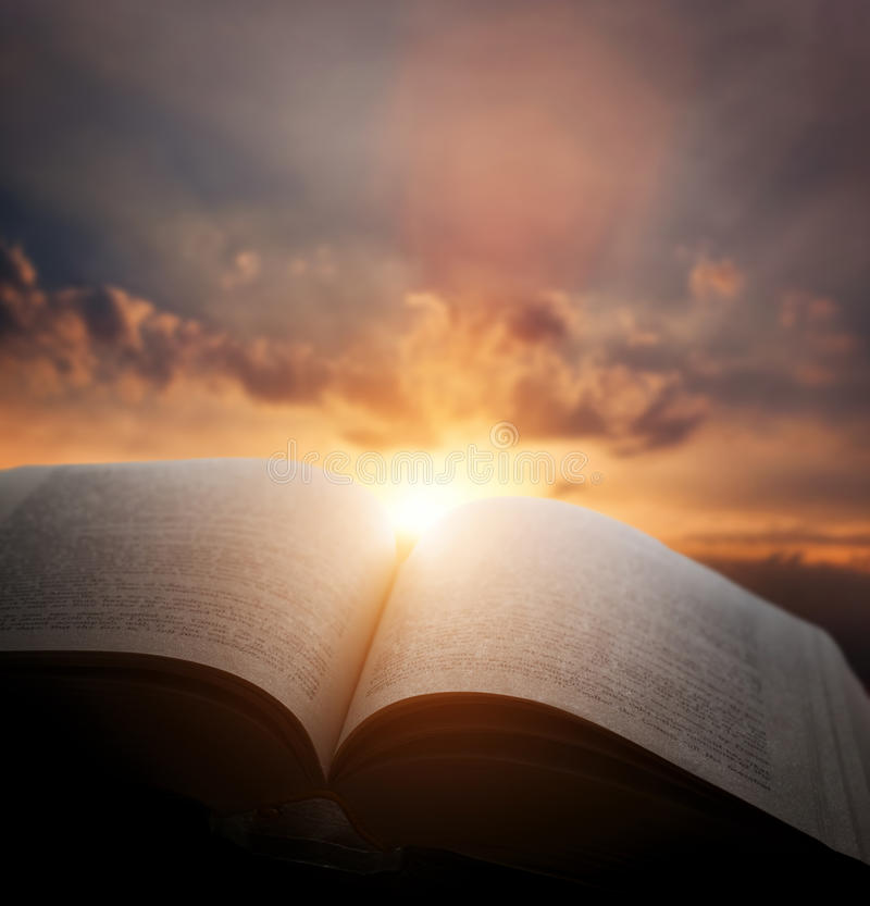 Free Open Old Book, Light From Sunset Sky, Heaven. Education, Religion Concept Royalty Free Stock Photography - 58266297