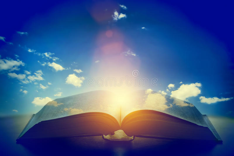 Open old book, light from the sky, heaven. Education, religion concept. Open old book, light from the sky, heaven. Fantasy, imagination, education, religion stock photography