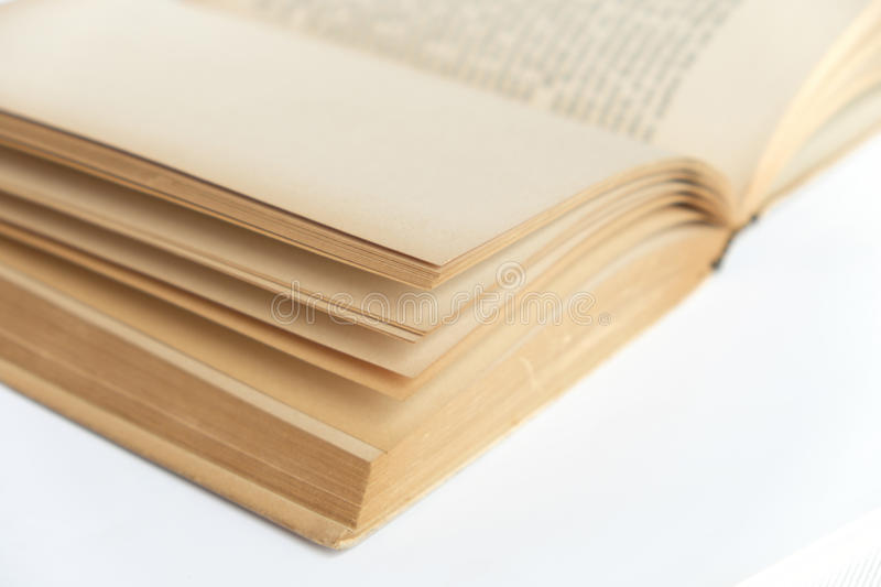 Open old book macro on white background stock photography