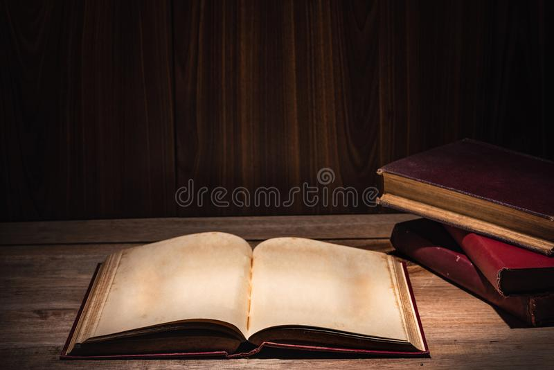 Open old book neary stack of books vintage dark style royalty free stock image