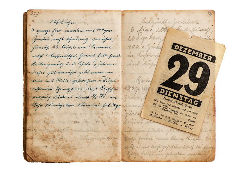 Open old cookbook with antique calendar page. Isolated on white background royalty free stock photo