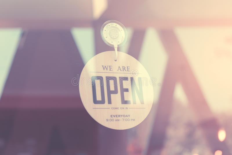 WE ARE OPEN - Open sign broad on a glass door Filtered image processed vintage effect royalty free stock photos