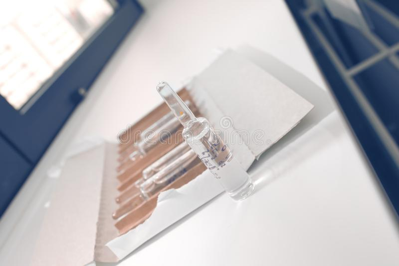 Open package of drug ampoules on the desktop.  stock photo