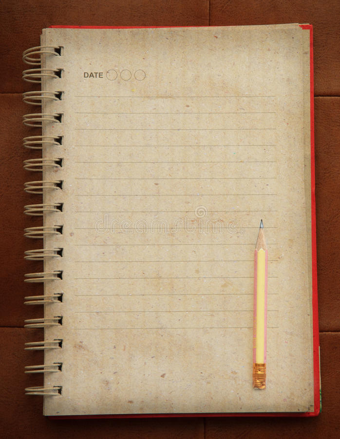 Open page of old diary paper book and writing pencil with empty page stock photo