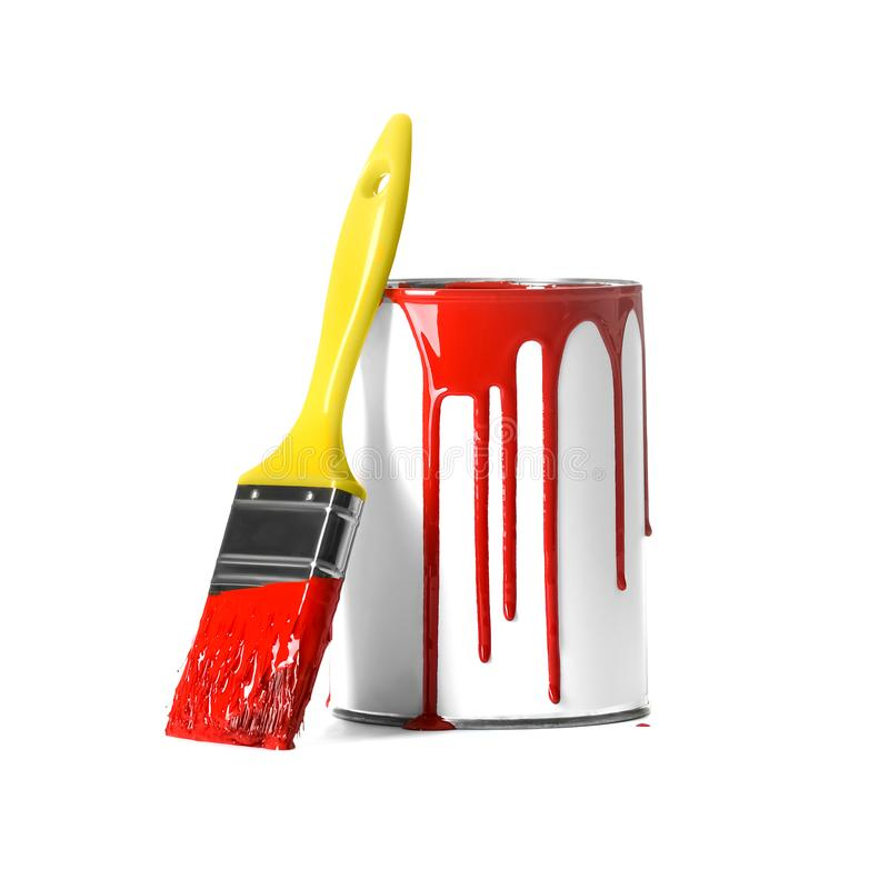 Open paint can with stains and brush. Isolated on white royalty free stock photos
