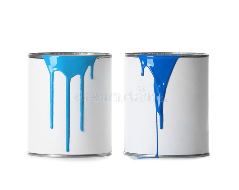 Open paint cans with stains. Isolated on white stock photography