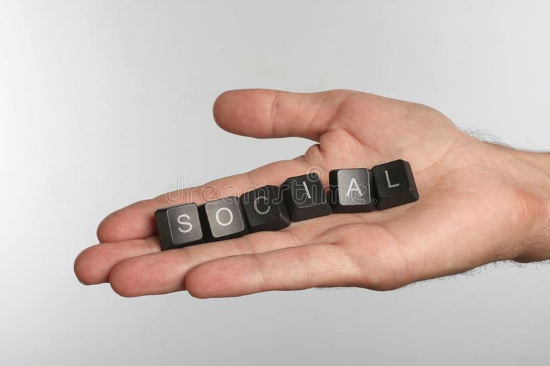Open palm with six computer buttons with word SOCIAL royalty free stock image
