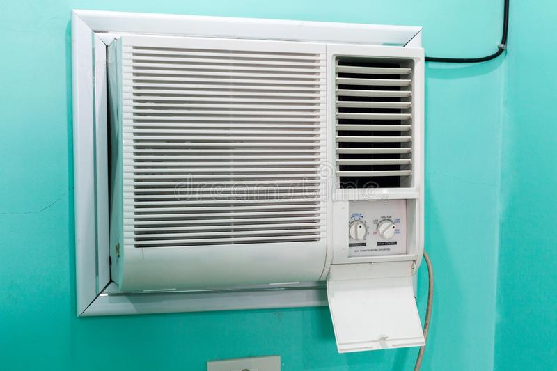 Open panel adjustment of a small room air conditioner. stock photo