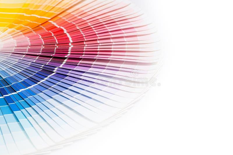 Open Pantone sample colors catalogue. Colour swatches book. Rainbow sample colors catalogue royalty free stock photos