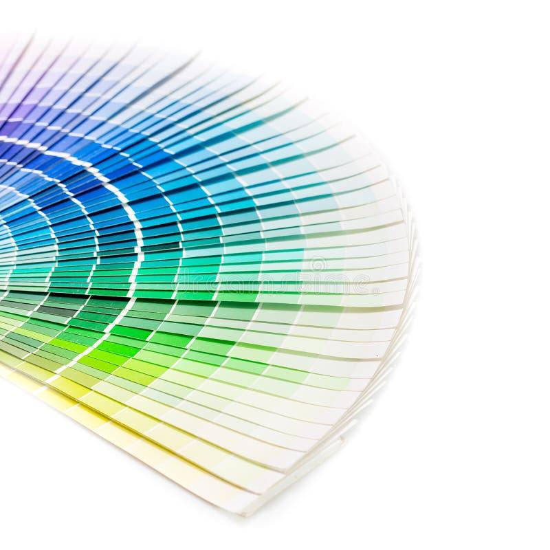 Open Pantone sample colors catalogue. Colour swatches book. Rainbow sample colors catalogue royalty free stock photo