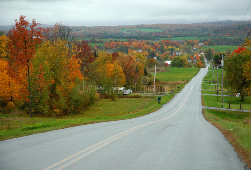 Open paved road. Road that is paved with fall foliage going down to fields of foliage in vermont a road leading to nowhere royalty free stock photo