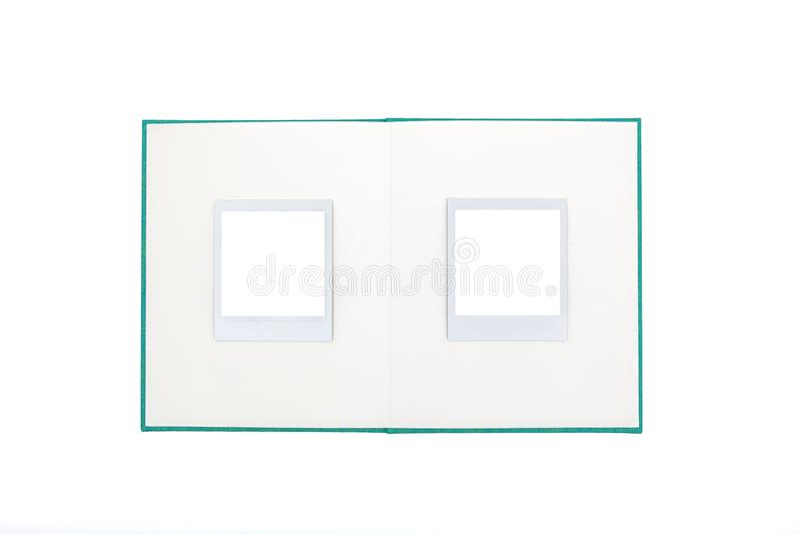 Open photo album with two empty polaroid frames stock image