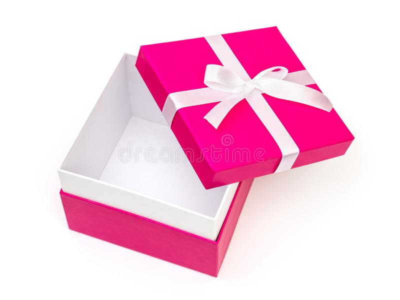 Open pink box with a gift and white bow isolated royalty free stock photos