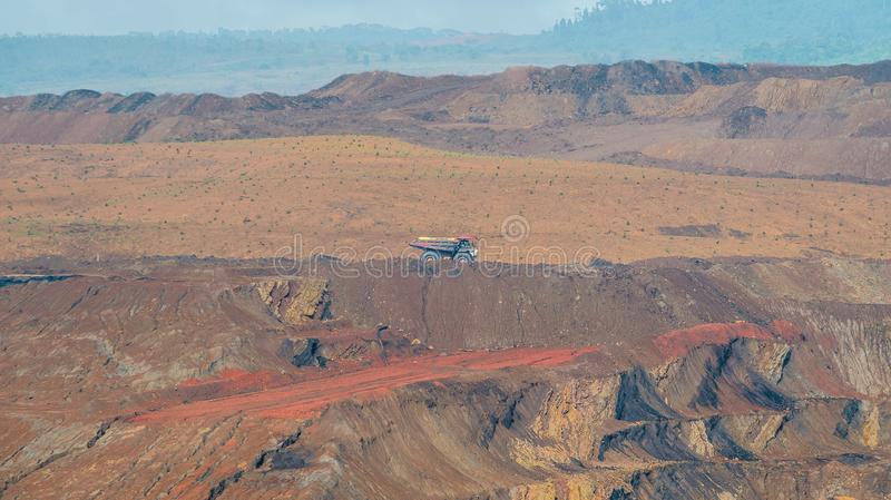 Open pit coal mining, Sangatta, Indonesia. Open pit coal mining activity in Sangatta, Indonesia. huge trucks are used to transport materials in this site royalty free stock images