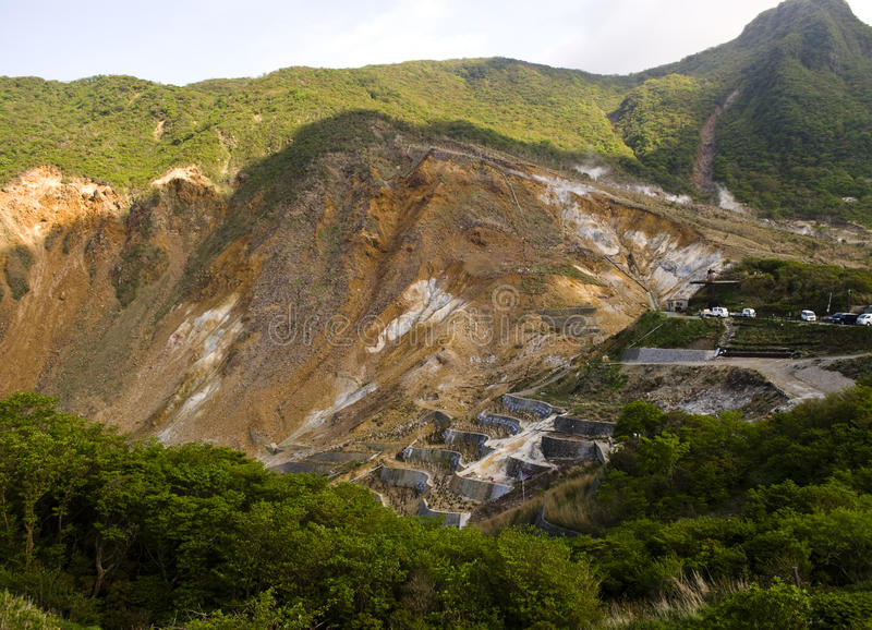 Open pit mine. Side of open pit mine in Hakone, Japan stock photography