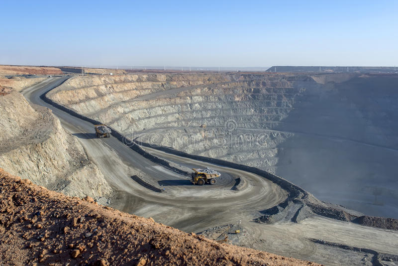 Open pit mine 01. Open pit mine in Mongolia, hauling trucks stock photography