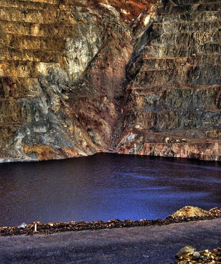 Open pit mining. Flooded with rainwater stock images