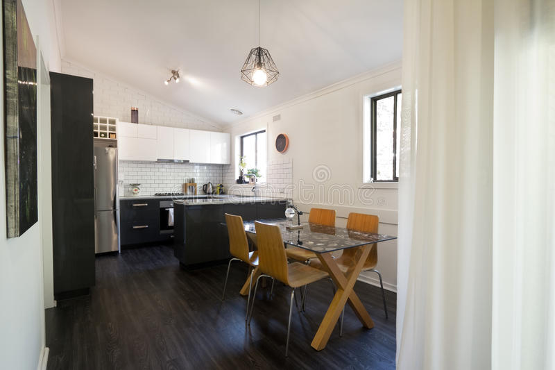 Open plan renovated kitchen and dining area stock photo