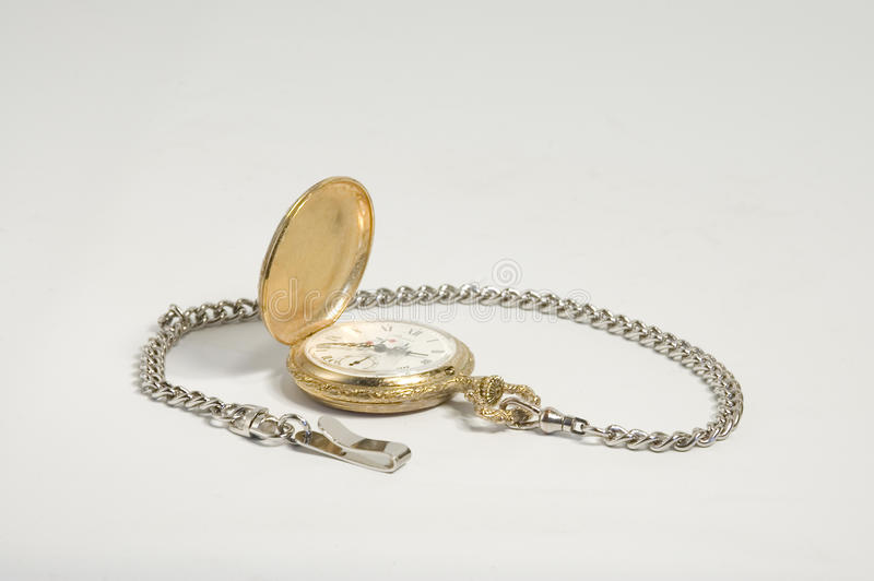Open pocket watch. Gold pocket watch opened with silver chain royalty free stock photos