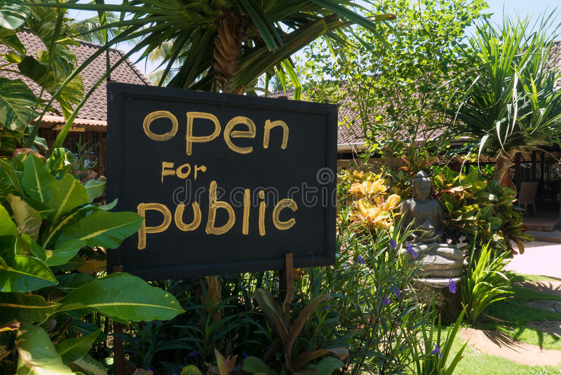 Open for public sign post with statue of buddha, Ubud in Indonesia stock photo