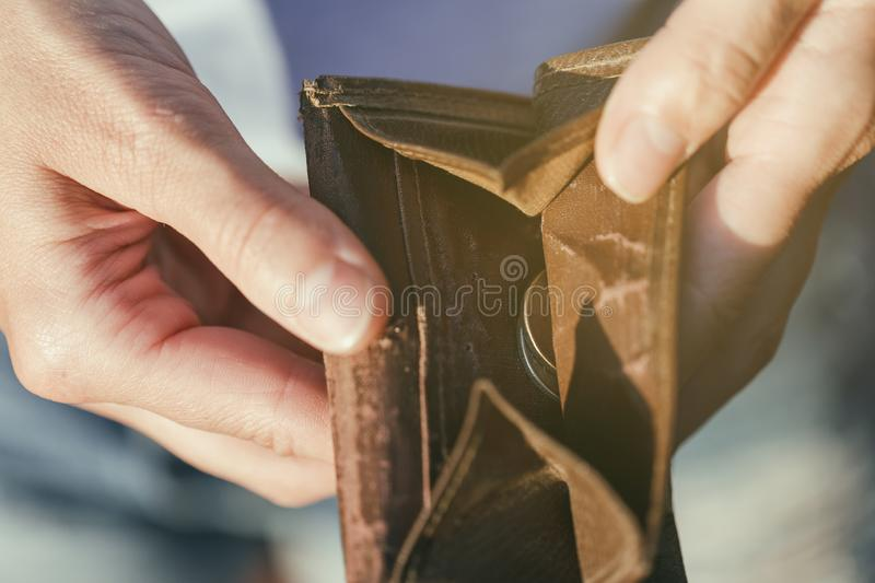 Open purse with coins inside as a sign of lack of money. Open purse with coins inside close-up as a sign of lack of money royalty free stock images