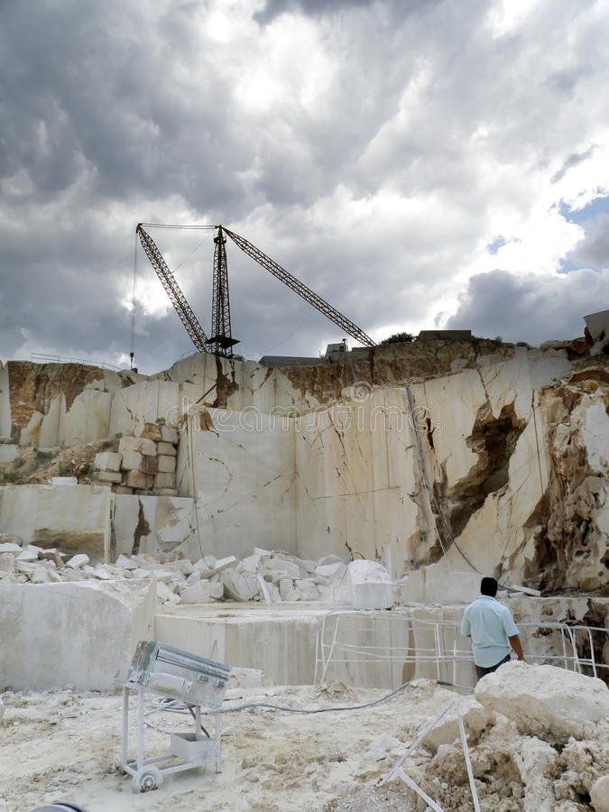 Open quarry of white marble stock images