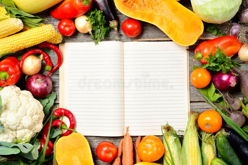 Open recipe book with set of raw organic vegetables on vintage download open recipe book with set of raw organic vegetables on vintage wooden table stock photo forumfinder Images