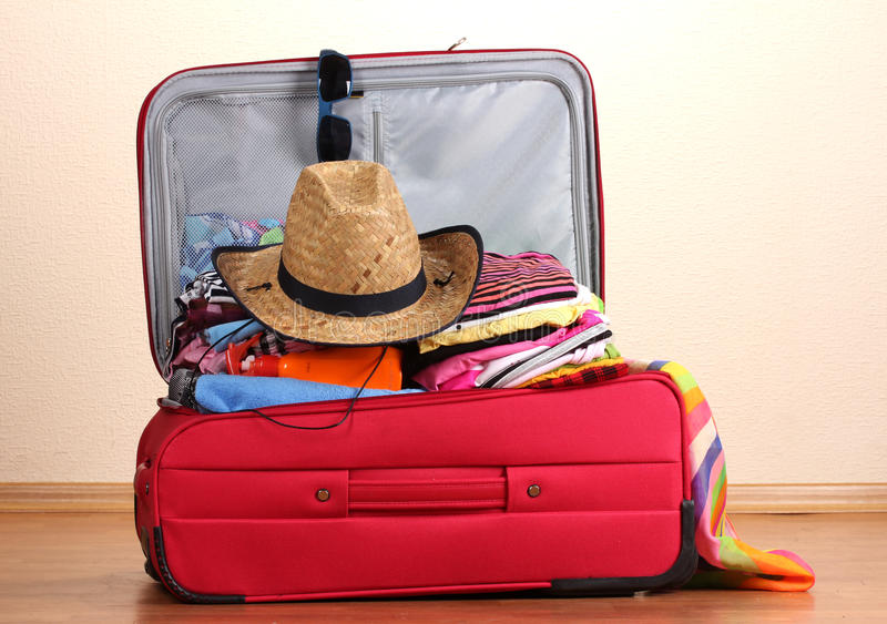 Open red suitcase with clothing royalty free stock photo