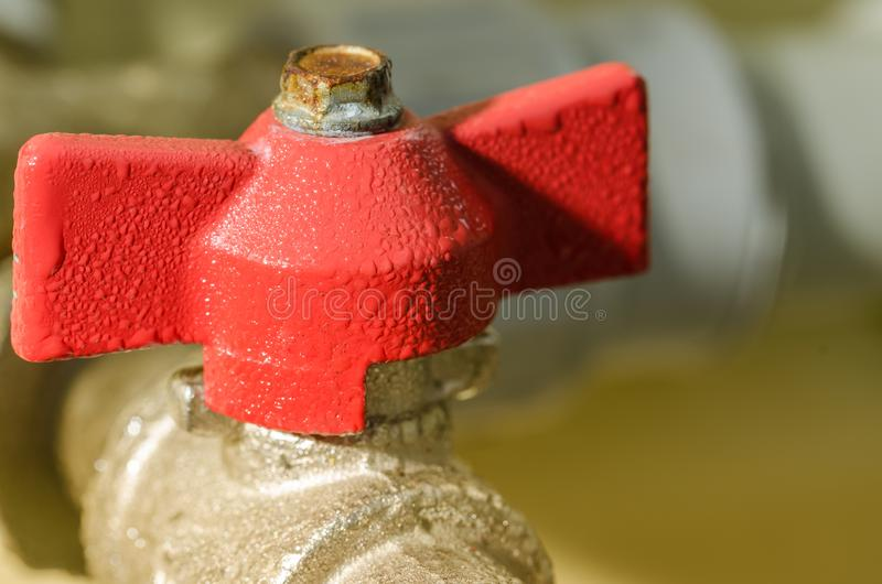 Open red valve water/crane with the gate for water stock images