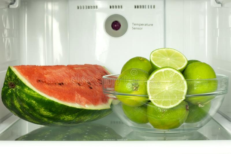 Open refrigerator with fruits stock images