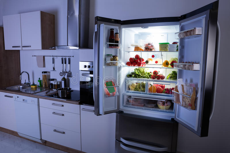 Open Refrigerator In Modern Kitchen stock images