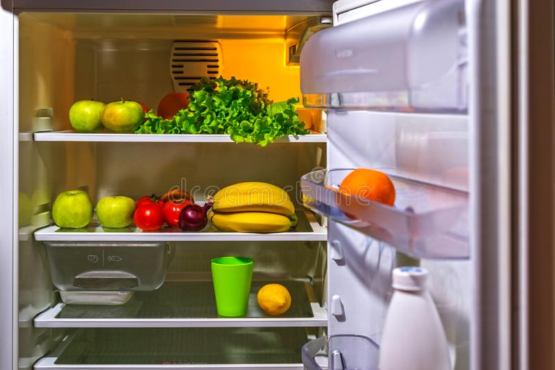 Open refrigerator with vegetarian food. royalty free stock photo