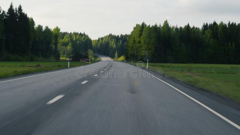 Open road. Driving a Car on a classic road at Finland. Passenger point of view. Sunny day. Open road. Driving a Car on a classic road at Finland. Passenger stock photo