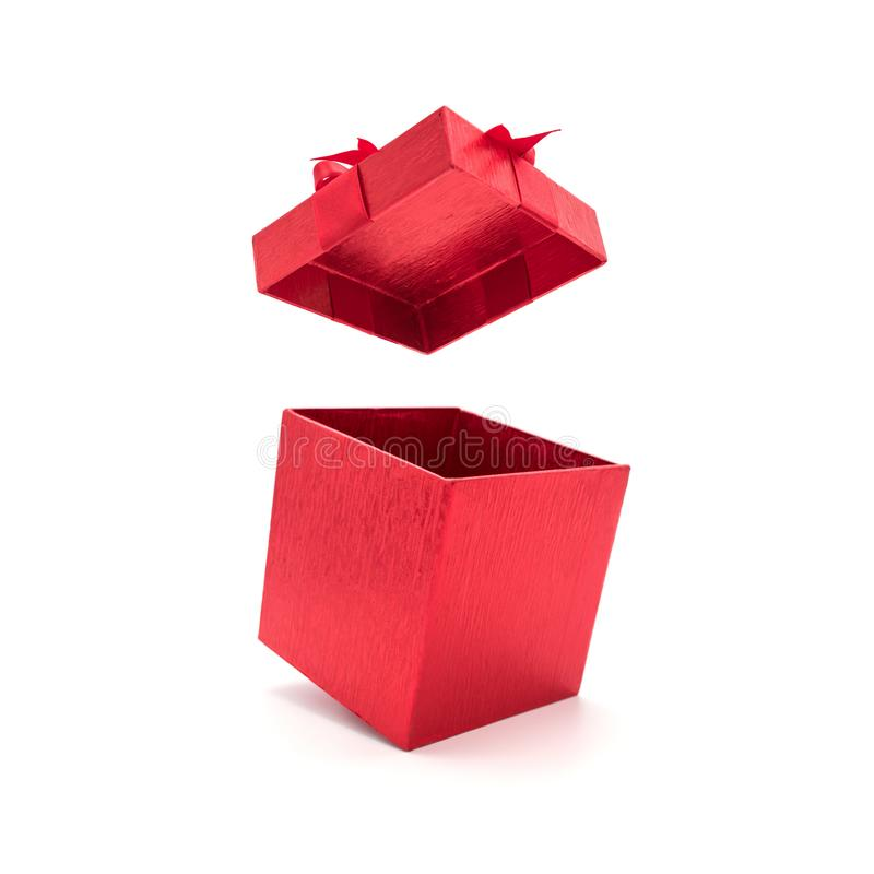 Open rode giftdoos met boog stock afbeelding
