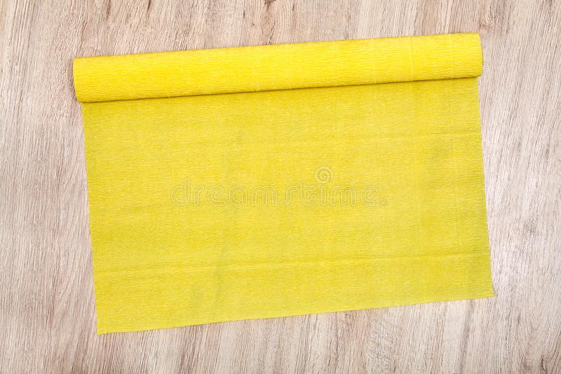 One unfolded roll of yellow corrugated paper lies on floor. royalty free stock photo