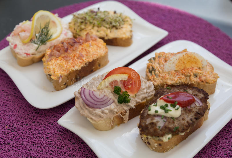 Open Sandwiches in Austria. Selection of Open Sandwiches in Austria. Toppings including tuna, fish, minced meat and egg can be seen stock photos