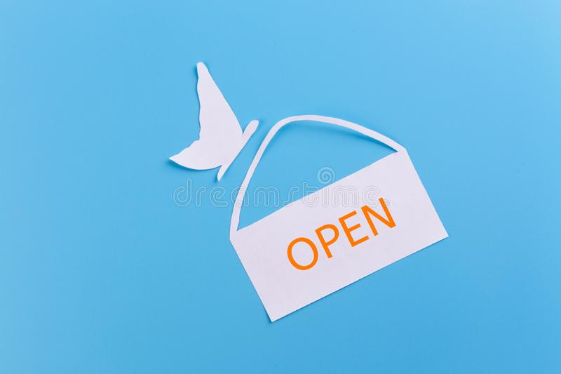 Open sign broad. Paper cut blue background stock photos