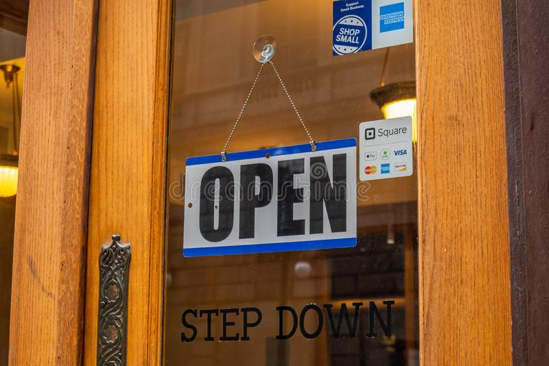 Open sign on a glass entrance door in Chicago, Illinois royalty free stock images