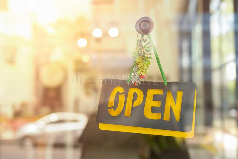 Open sign hanging front of cafe with colorful bokeh light background. Business service royalty free stock images