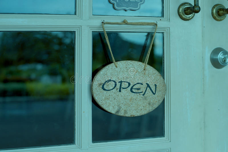 Open sign hanging in front of shop stock image