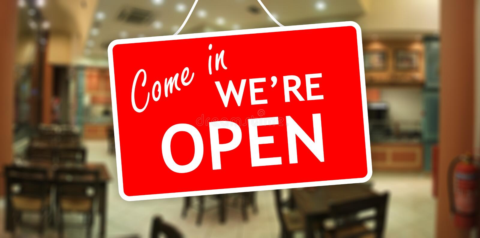We are open sign on glass storefront stock photo