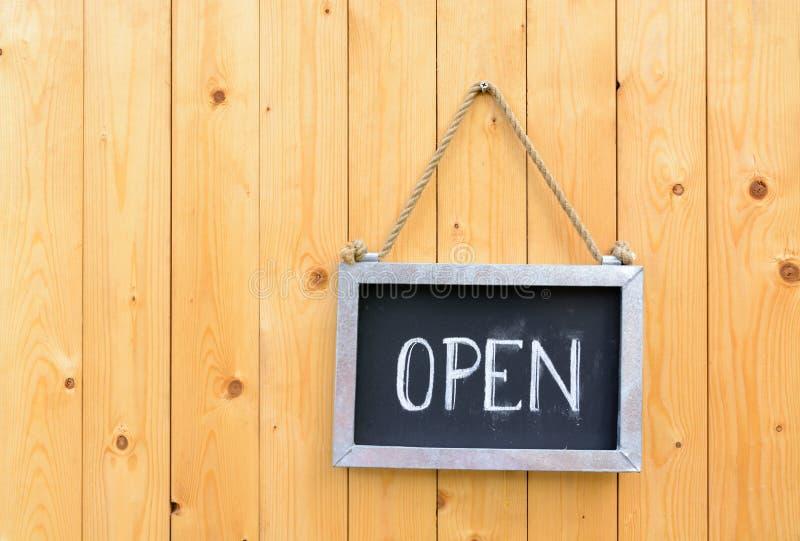 Open sign on wooden door royalty free stock photo