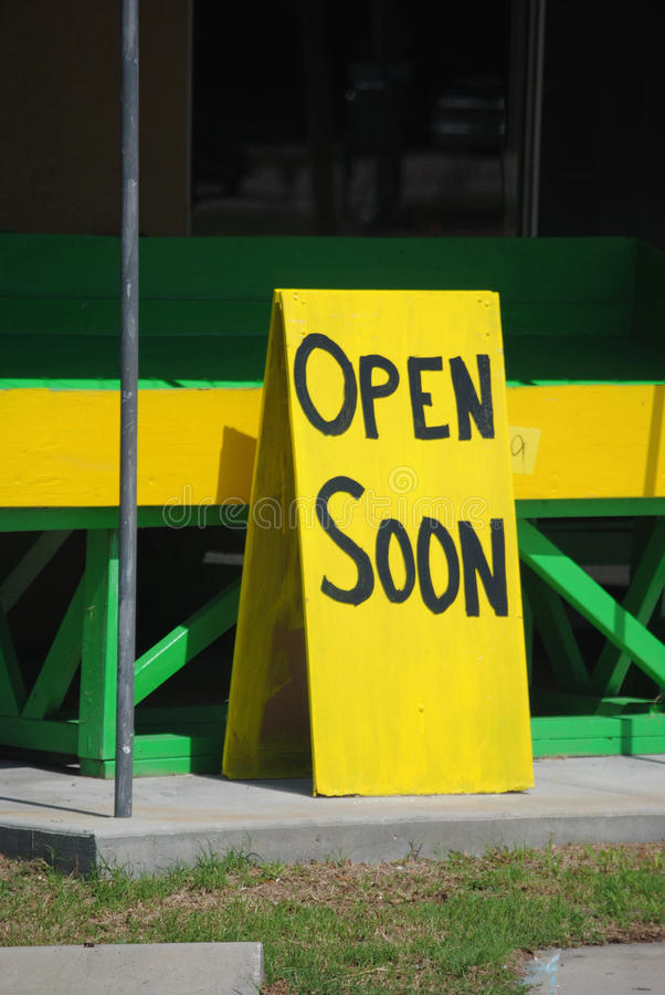 Open soon. Sign showing business will soon open royalty free stock photography