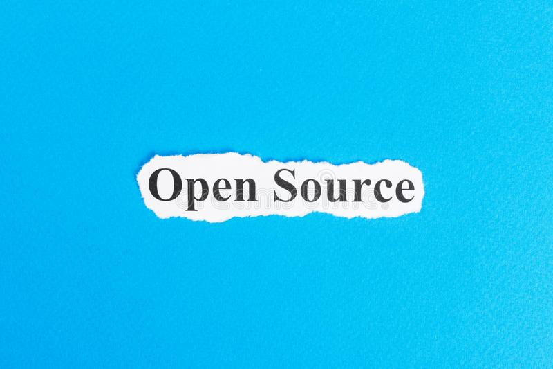 Open source text on paper. Word Open source on torn paper. Concept Image.  royalty free stock photography