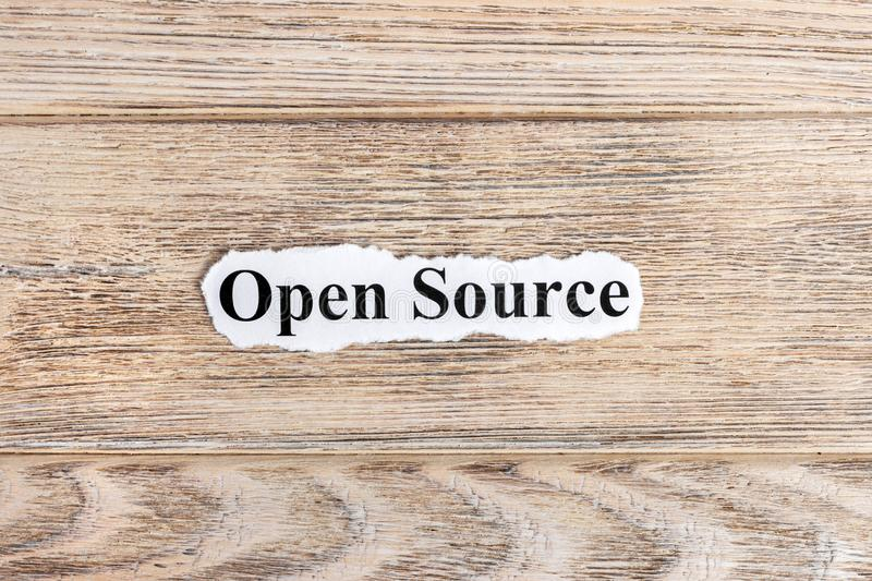 Open source text on paper. Word Open source on torn paper. Concept Image.  stock photos