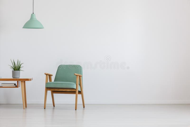 Open space with mint chair royalty free stock photography