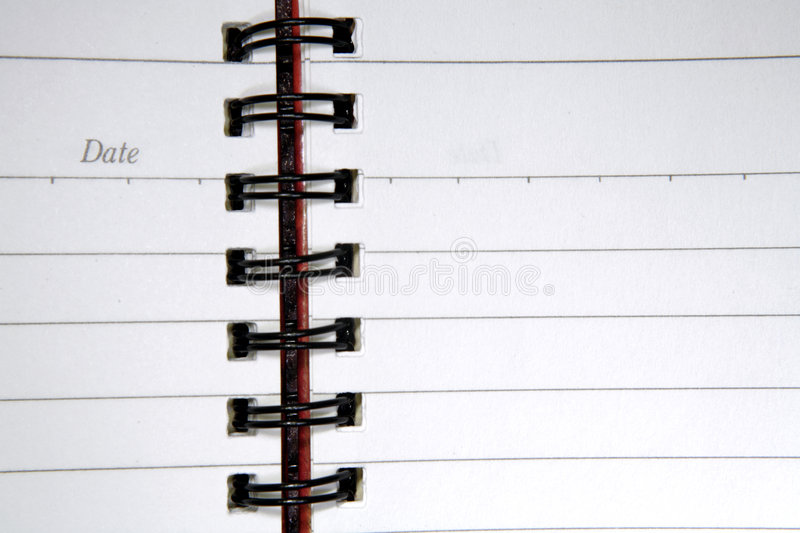 Open spiral notebook stock image