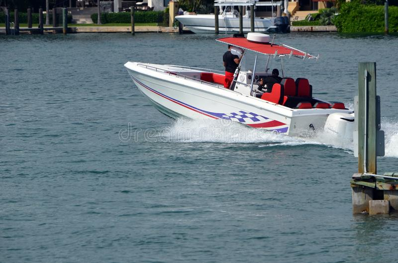 Open sports fishing boat powered by two outboard engines. A small sport fishing boat powered by two outboard engines speeding on the Florida Inra- Coastal royalty free stock images