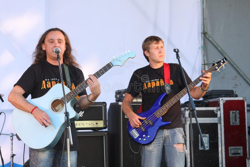 On the open stage of the festival are musicians in a rock band, Darida. The city of st. petersburg, russia, europe. 22/ 08/2009 celebration of day of the royalty free stock photo