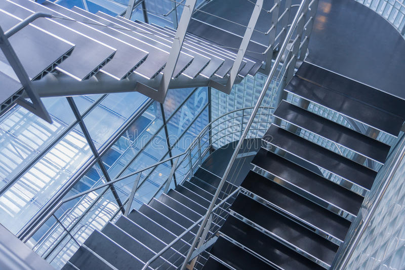 Open stairwell in a modern office building. Open steel stairwell in a modern office building stock photography
